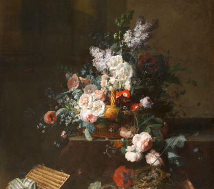 Still life with basket of flowers and box of ribbons
